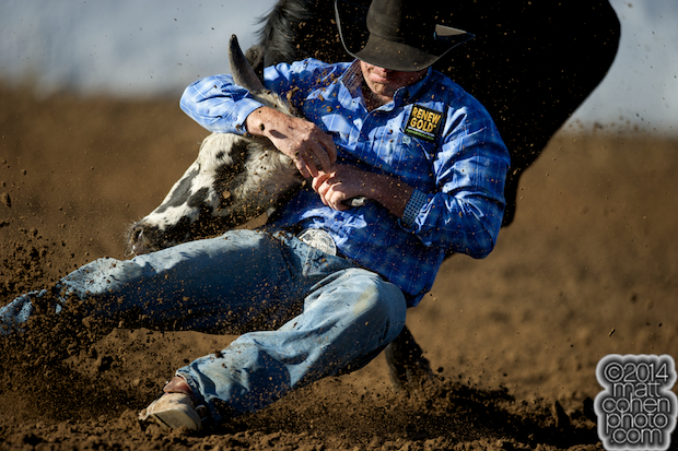 Steer wrestler Ethen Thouvenell of Hooper, UT competes at the Clovis Rodeo in Clovis, CA.