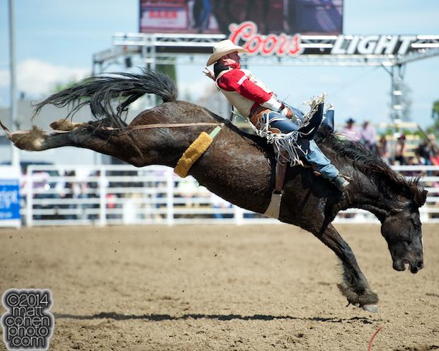 Bareback rider Steven Peebles of Redmond, OR rides Darth Vader at the Clovis Rodeo in Clovis, CA.