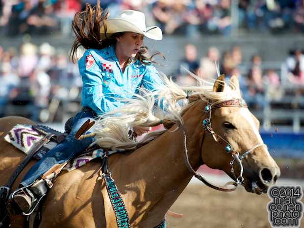 Barrel racer Brittany Pozzi of Victoria, TX competes at the Clovis Rodeo in Clovis, CA.