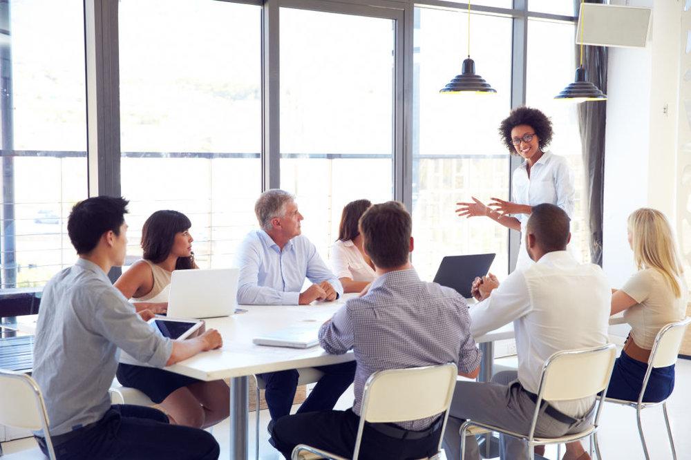 bigstock-Businesswoman-presenting-to-co-90004202.jpg