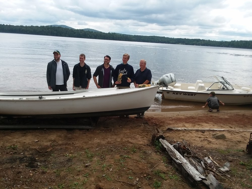Mimi and Zella's families with Mimi boat.jpg