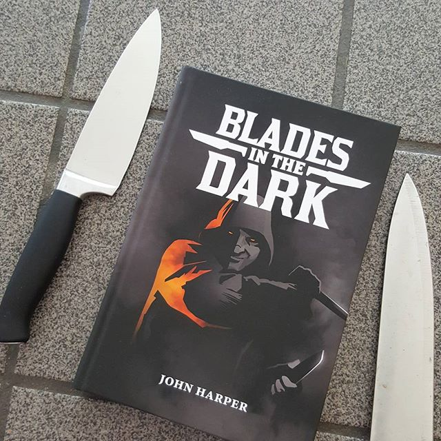 #BookOfTheDay is #bladesinthedark. Really excited to read this one! What are you reading? . . . . . #onesevendesign #evilhat #evilhatproductions #dorks #dorksindungeons #d20 #dungeonsanddragons #dnd #pathfinderrpg #savageworlds #rpg #tabletopgames #improvcomedy #portsmouthnh #tabletoprpg #faterpg #seacoastnh #dungeonworld #knives #blades #rogue #knifeporn