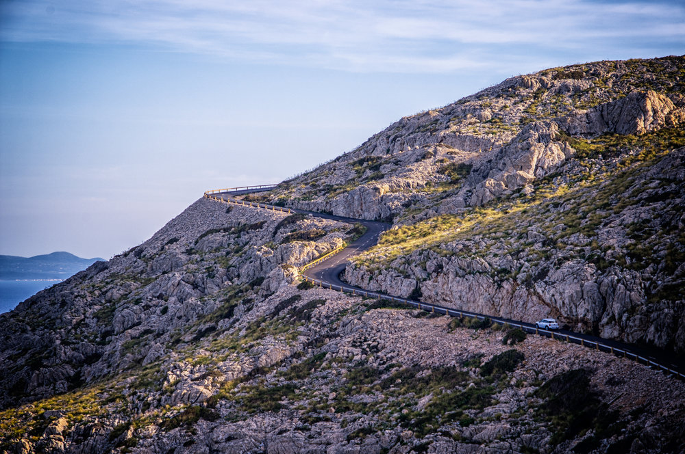 Driving up a spiraling hill in Spain. Photo by  Patrick Baum .