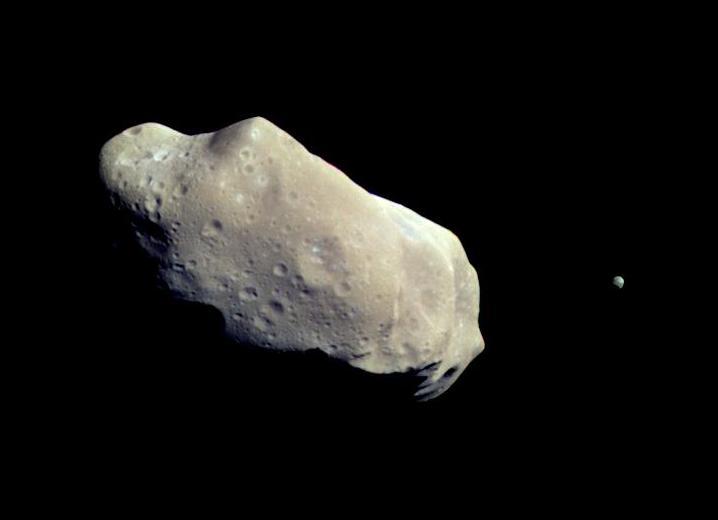Asteroid 243 Ida and her moon Dactyl. Photo by NASA via  Wikimedia .