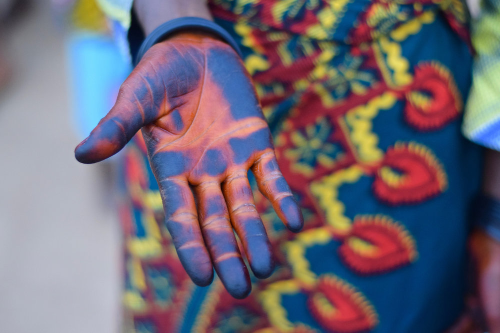 Colourful stories. Painted hands, probably at Holi -- A Hindu Spring festival. Photo  Lenny Miles .
