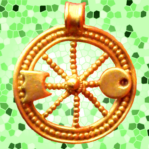 Celtic Wheel of the Sun pendant. Photograph by  PHGCOM .