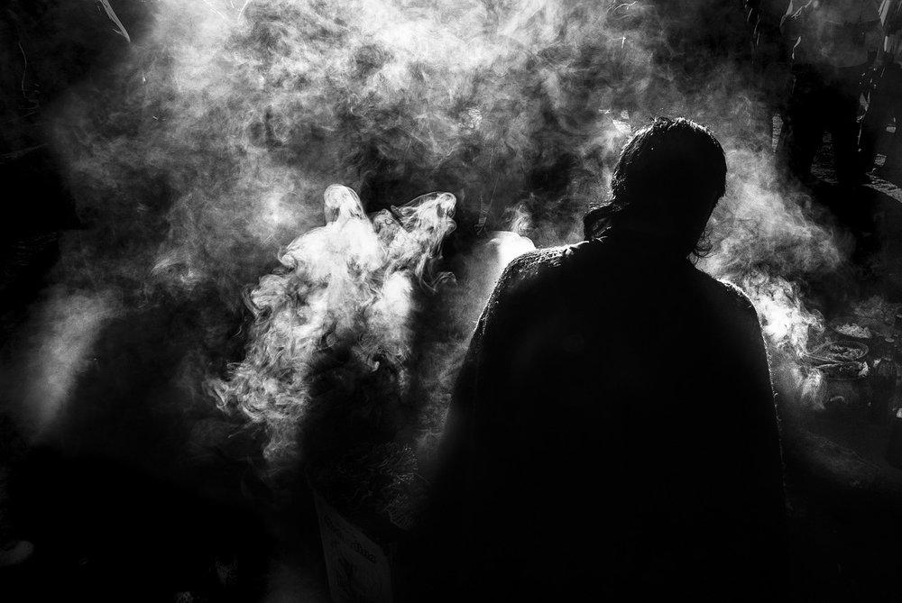 Photograph of smoke during ritual, by  Sebadelval .