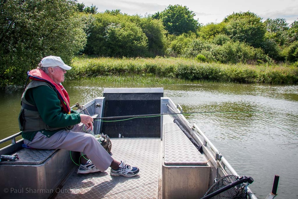 A last look at Allan Sharman fly fishing from the wheelyboat at Arlington reservoir and finally enjoying some sunshine.