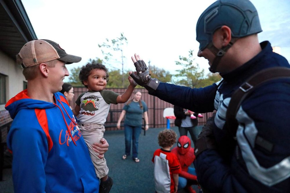 Super Heroes stop by the MICAH House to play with children during the BUDDY Program. Photo Credit: Joe Shearer,  The Daily Nonpareil