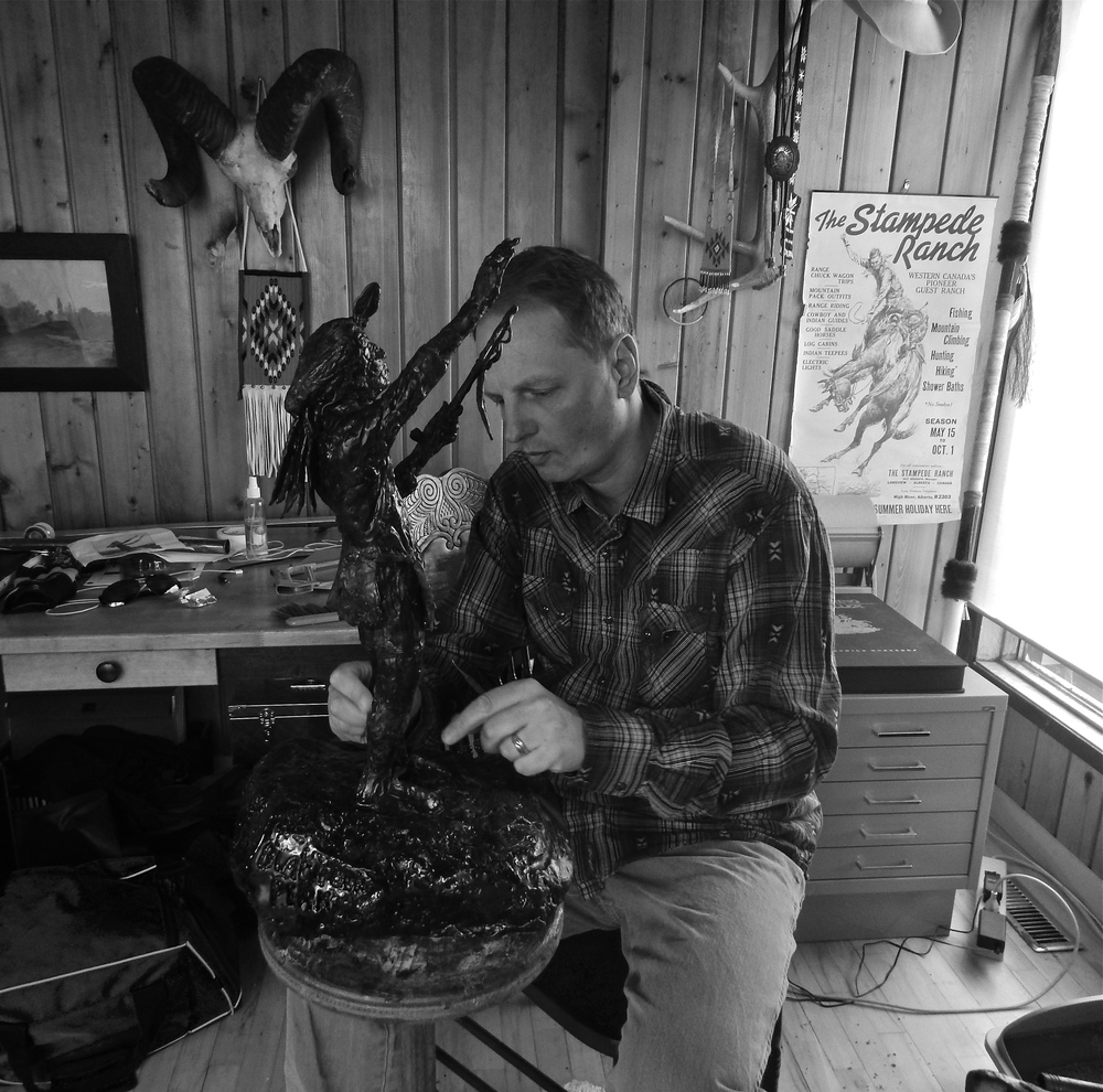 Paul works on a wax model of Nicholas Black Elk for a bronze sculpture entitled, 'Black Elk's Peak' in 2016.