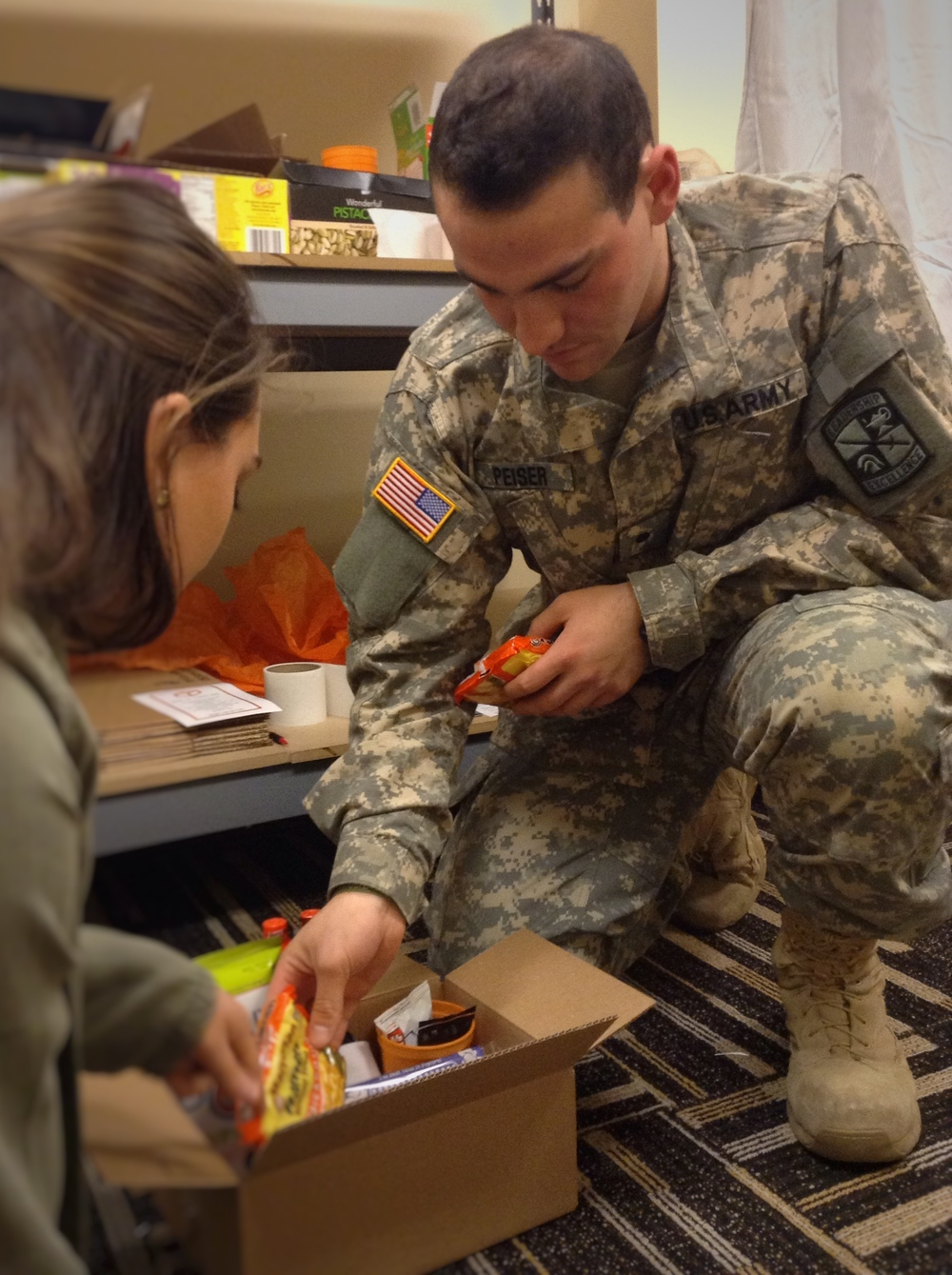Peiser fills a Study Energy Box with packages of ramen noodles on February 18, 2016. in the Stuff in a Box Student Center office. The company shops in bulk at Walmart to buy supplies for the care packages. They have four different types of boxes: Fruit Box, Wellness Box, Study Energy Box and Tiger Box ranging from $10.99 to $29.99.