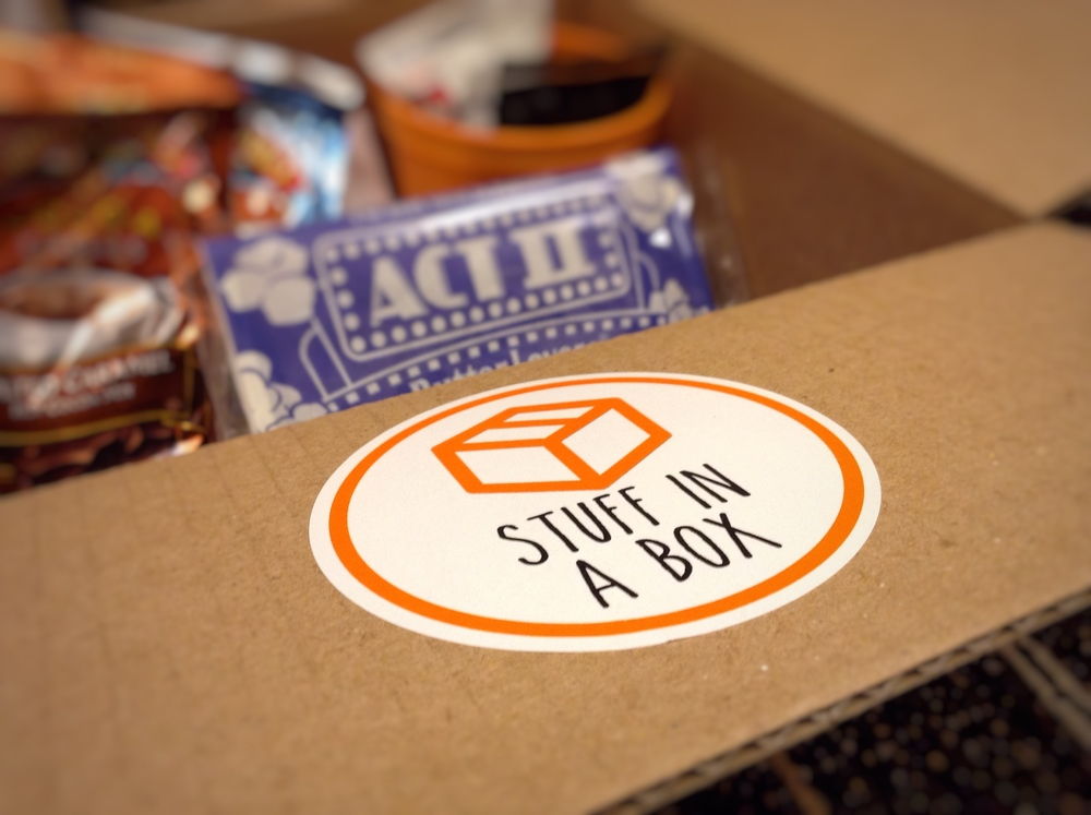 A box sits in the Student Center on February 18, 2016 before being sealed and given to a student.  Each care package includes a Stuff in A Box sticker along with tissue paper and a flyer promoting the website. The company makes special boxes for special occasions like chocolate-covered strawberries on Valentine's Day, a Final's week box and a Halloween box.