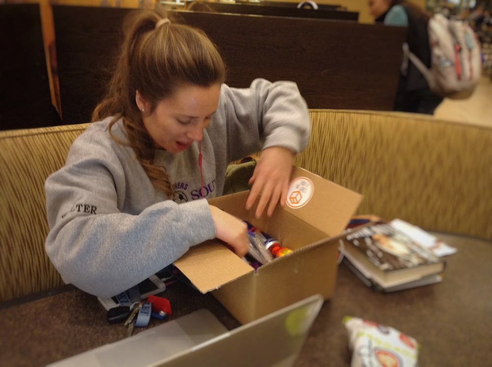 University of Missouri junior Bailey Walter opens the Study Energy Box in the Student Center  on February 18, 2016 . Peiser and Gilstrap chose to give the box to Walter because she was studying hard on her laptop. Peiser explained the service to Walter and allowed her to keep the box.