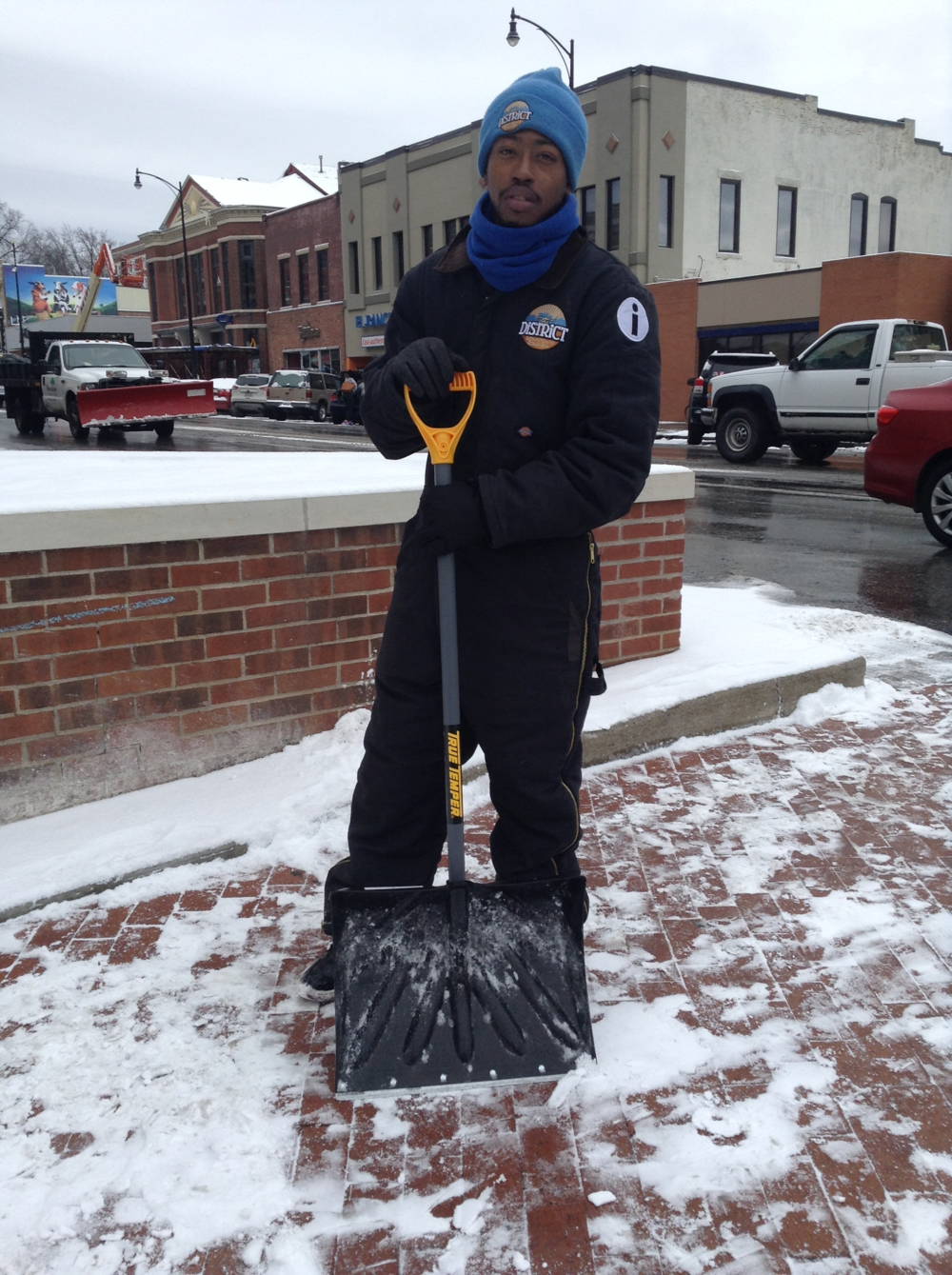 "The District employee, 26-year-old Maurice Figures shovels snow off the sidewalk at the intersection of 10th and Broadway in Columbia, Mo. on February 10, 2016. ""I love trying to make people smile by cleaning up that area,"" Figures said. ""I'm all about the community coming together as one. If we all come together and we get our minds to reach a common goal, one day, we can grow together full of love."""