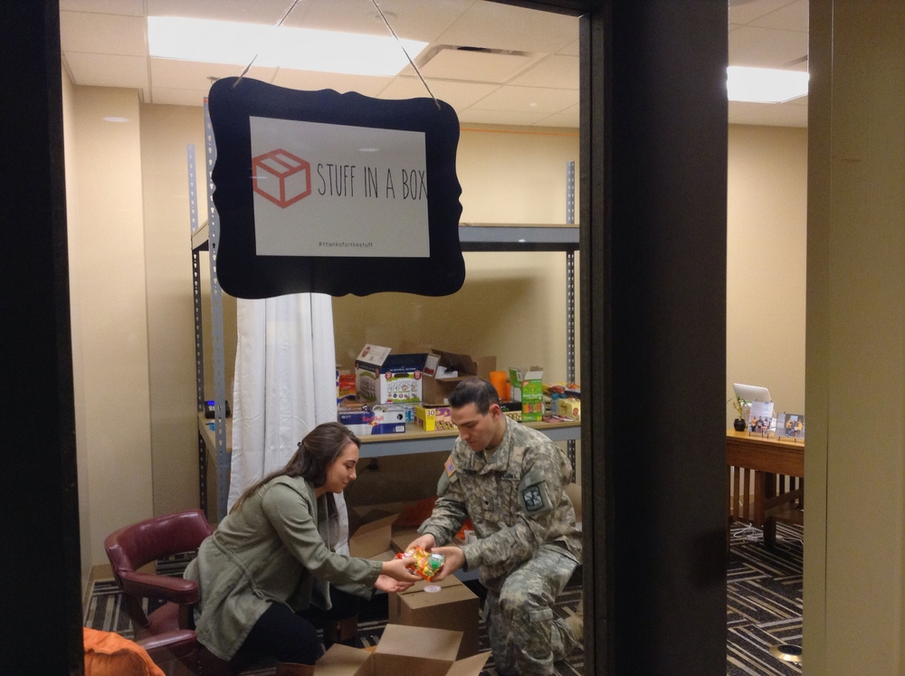 Stuff in a Box CEO Natalie Gilstrap and COO Jason Peiser package a box inside their office in the Student Center on February 18, 2016. The Study Energy Box included popcorn, hot cocoa mix, candy, 5-hour Energy, a cup and more. They gave away the box to a studier in the Student Center as part of a promotional stunt to make students aware of their service.