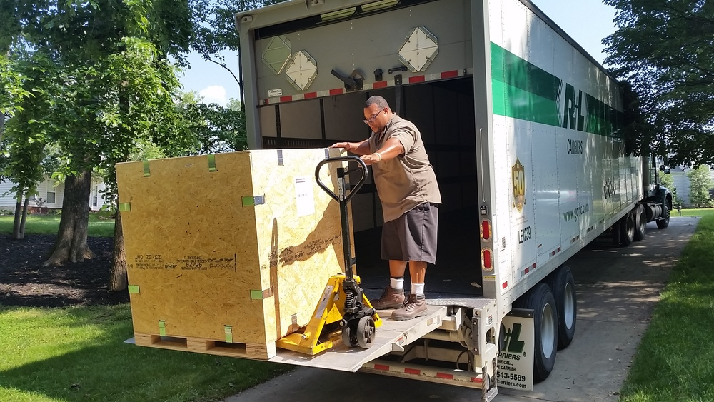 Getting the crates loaded onto the truck on our sloped driveway was exciting for truck driver, Tony!