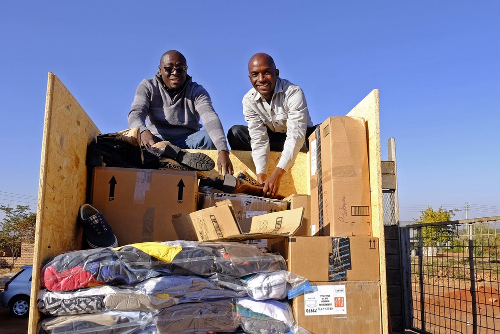 Percy and Paul Mukwiza unload a crate!