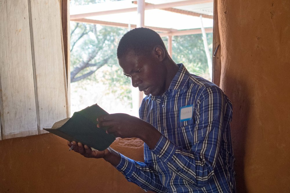 Mushiba, a brilliant and friendly young student, reads Scripture from the Lozi Bible.