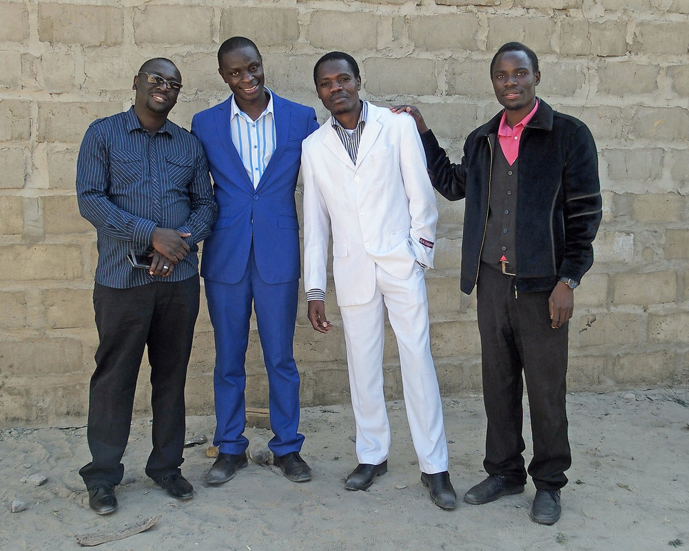 Pastor Percy Muleba (L) with three of his students in Mongu, Zambia
