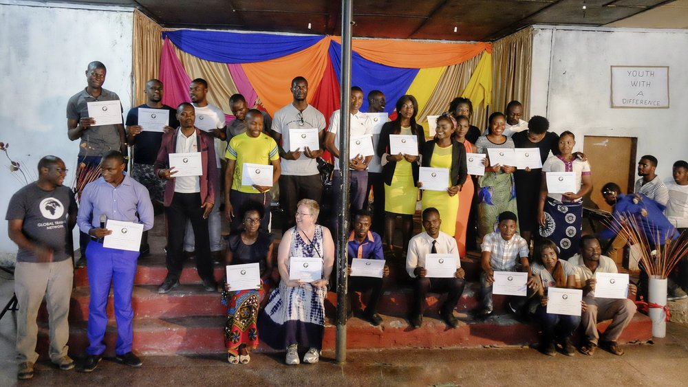 Our Mongu students proudly hold their Certificates of Completion after a week of intensive training!