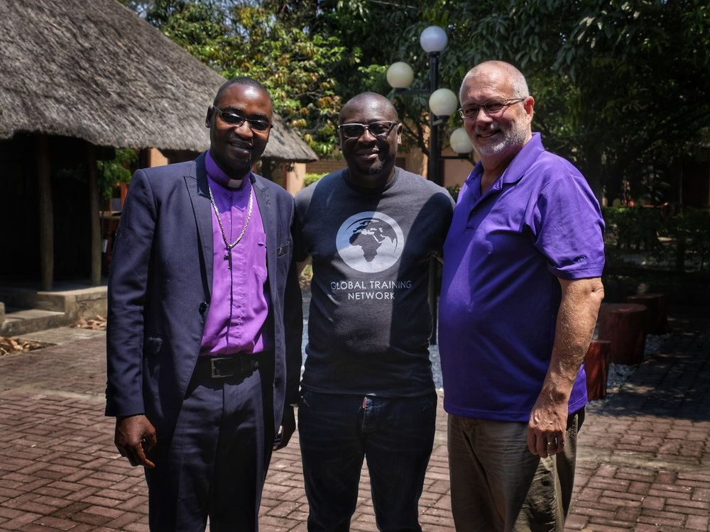 Bishop Manyando (L) with Percy and Doug
