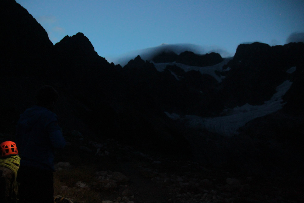 Zach and I looking up at the clouds rolling over Shuksan just before sunrise.