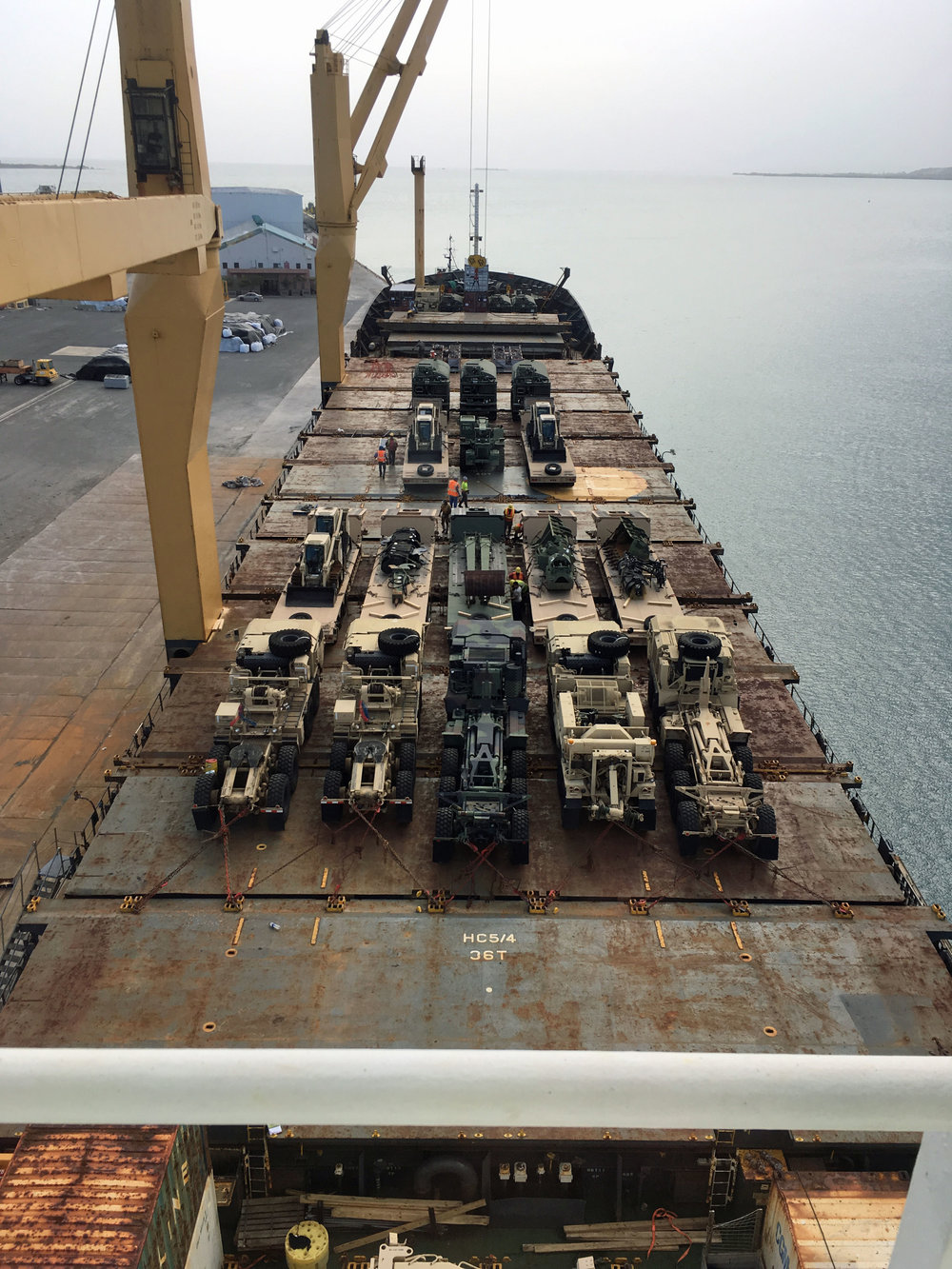 "The M/V ""Seattle"" has her deck cargo lashed down on top of the hatches after they were also filled with Army Corp of Engineers equipment."