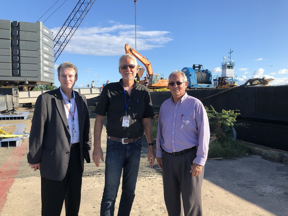 I'm standing between Compassion Services director Robert Rodenbush and local pastor Les Piercell who were instrumental in putting all the cargo together for this relief voyage.