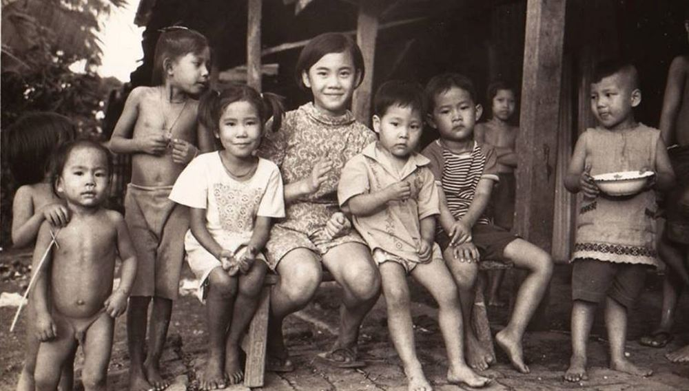The Sudhinaraset Family and Neighborhood Kids in Thailand 1960.