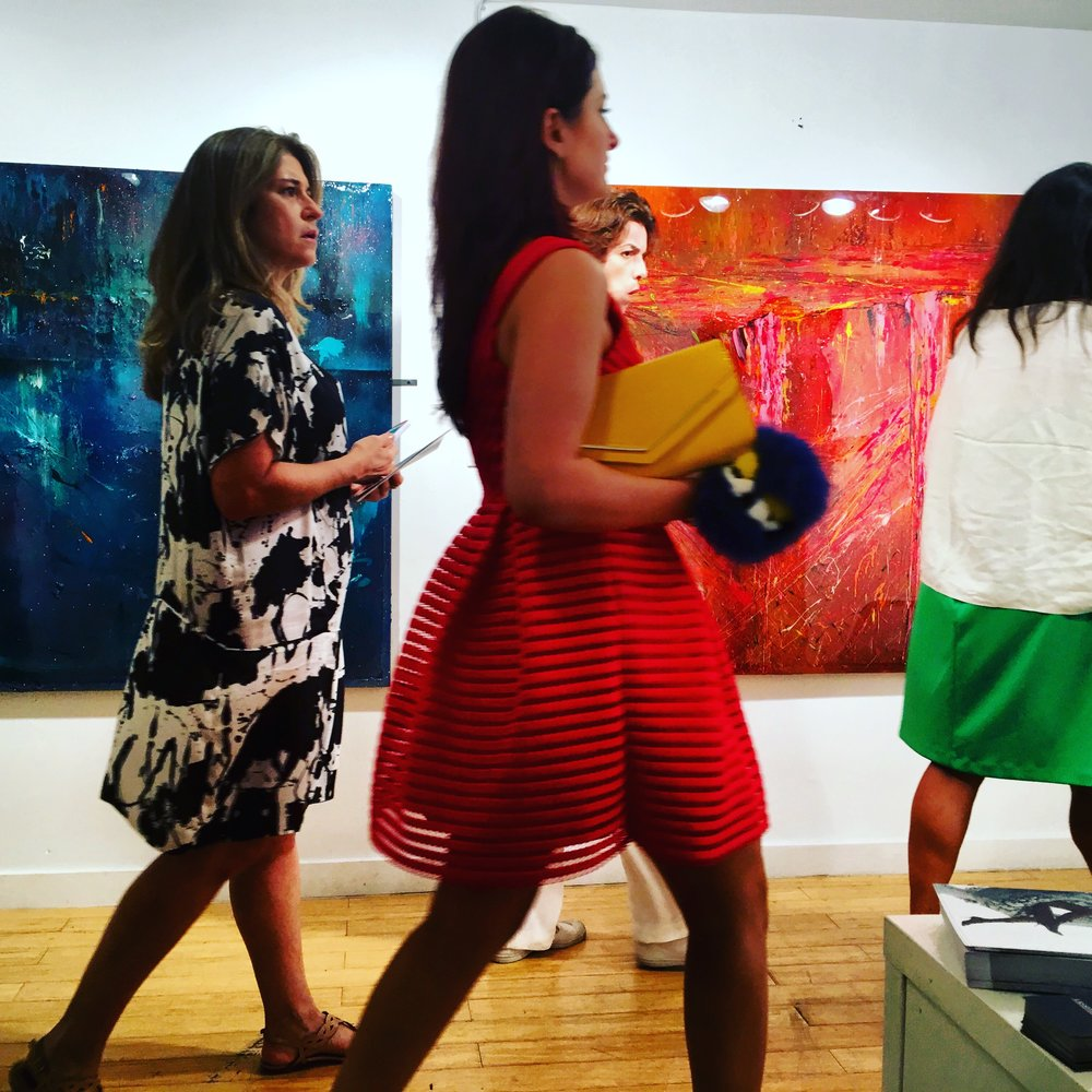 Monica Ard's Blue No. 4 and Persephone seen here as fair goers proceed through the Lassiter Fine Art booth at Aqua Art Miami