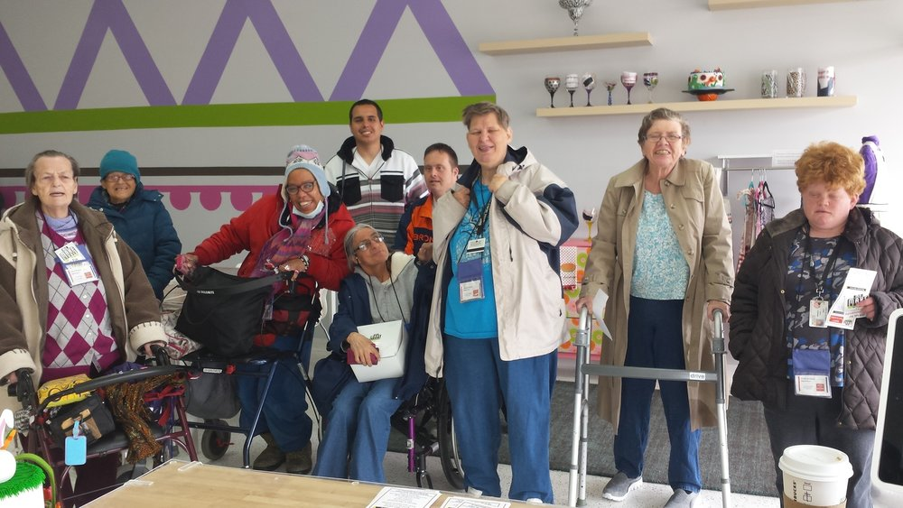 An Easter Seals Group Decorating Cupcakes