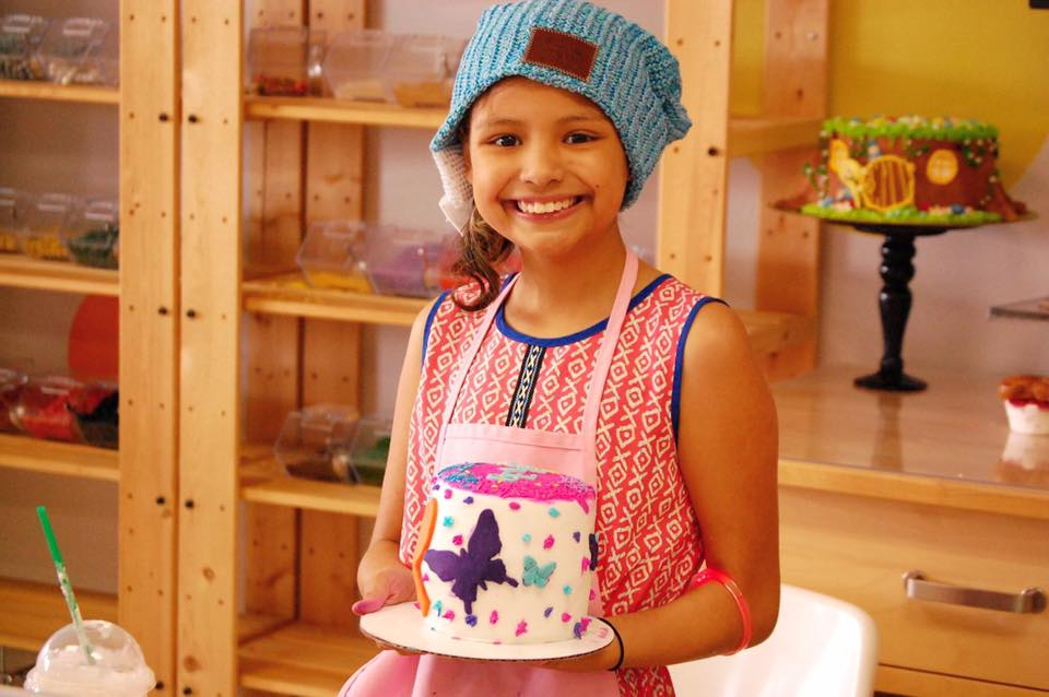 Bella from Love Your Melon Decorating a Cake