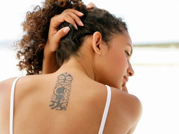 woman with back tattoo