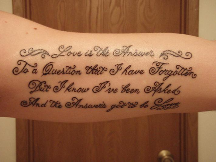 script lettering tattoo