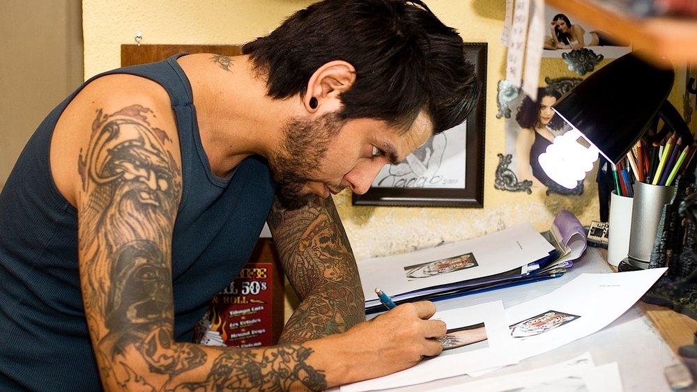 tattoo artist designing