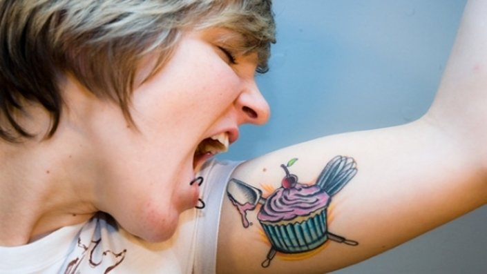 girl with a cupcake tattoo