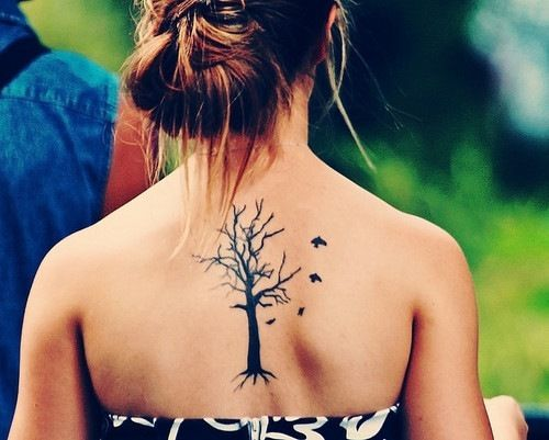 woman with a back tattoo