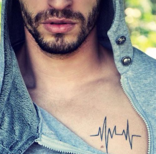 man with a small chest tattoo