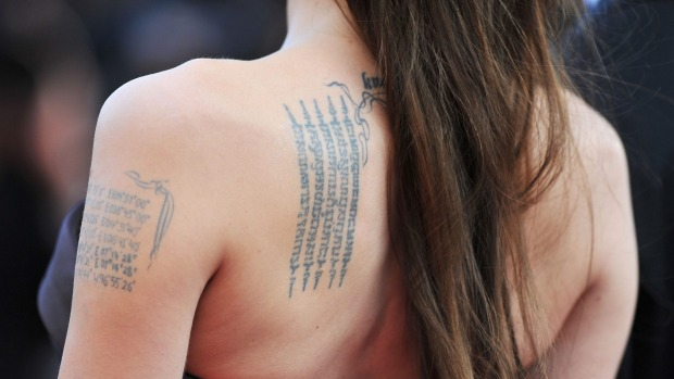 woman back tattoo