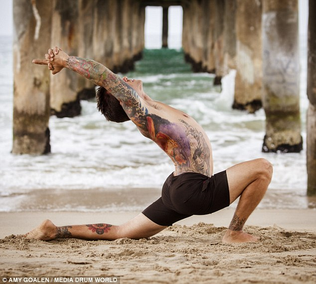 yoga man with tattoo