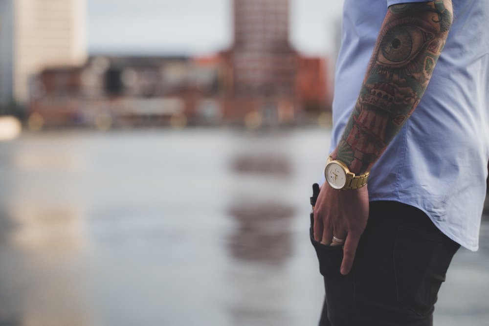man with tattooed arm