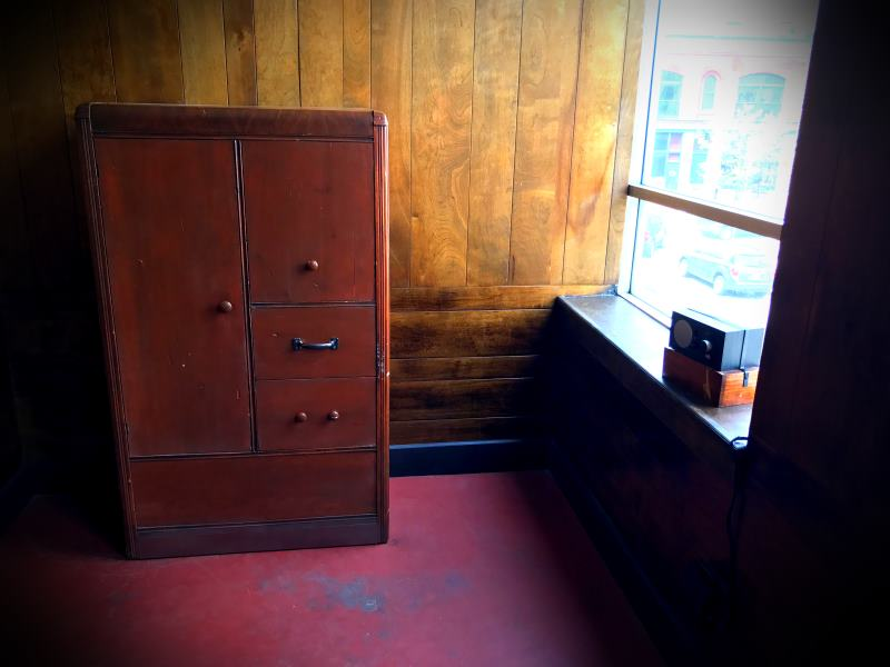 ...an old dresser and Crosley radio can be seen.