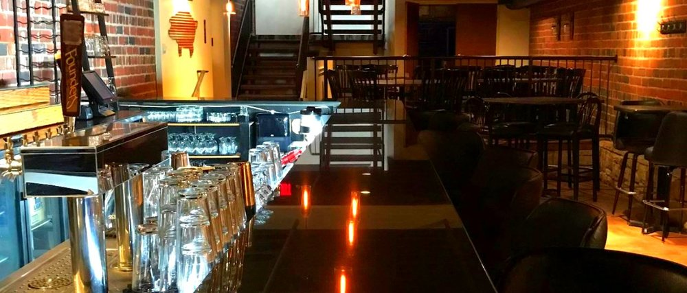 Whiskey Alley  has a stairs-tunnel entrance from  Street Side  restaurant and a back alley exit onto Court Avenue...