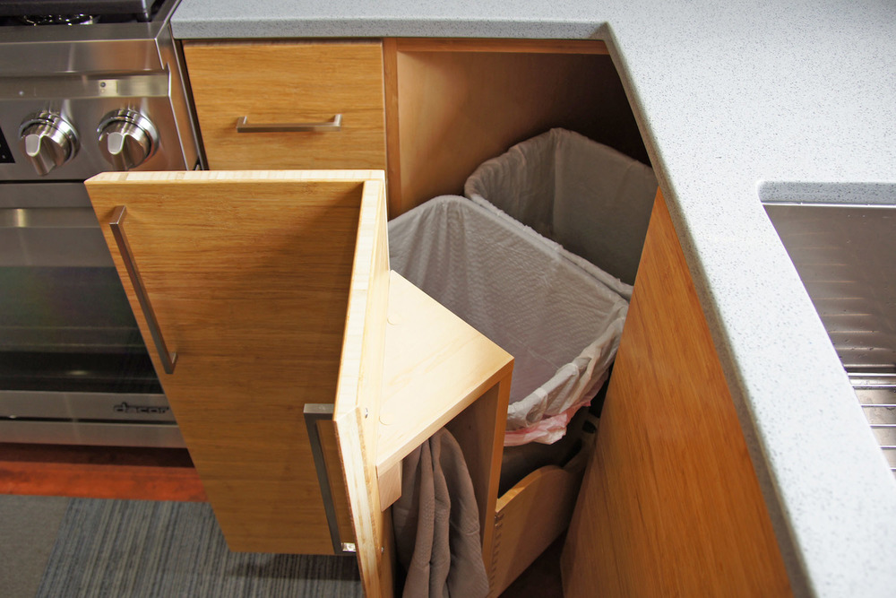 04 corner trash pull out and towel storage.jpg