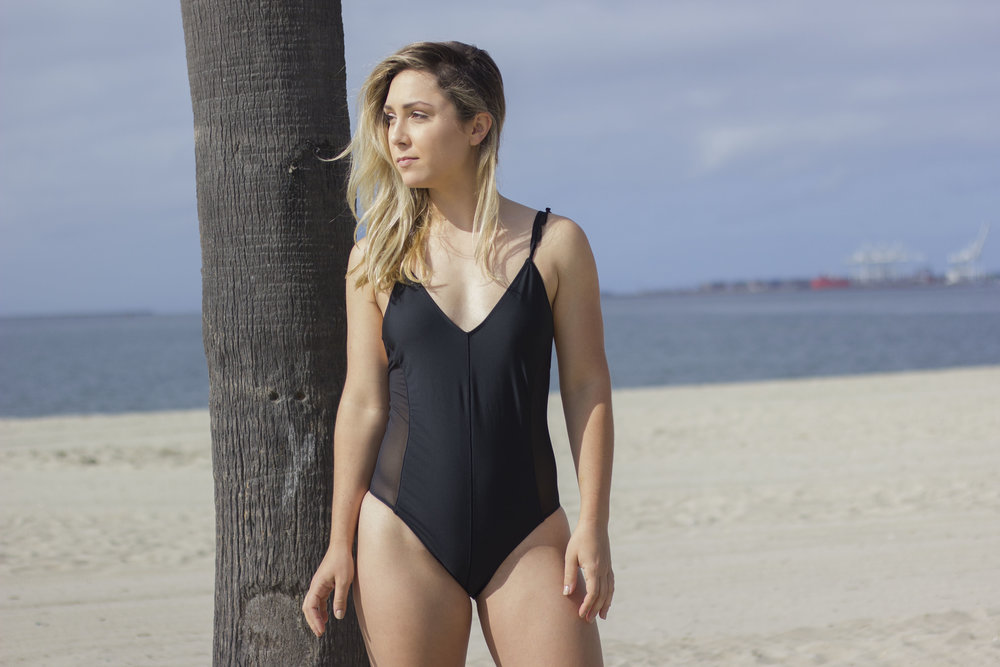 bdb294a04f6 Just a simple, black one piece that still makes you feel 100% like a boss  lady. If I could style this on anyone, I would give this swimsuit ...