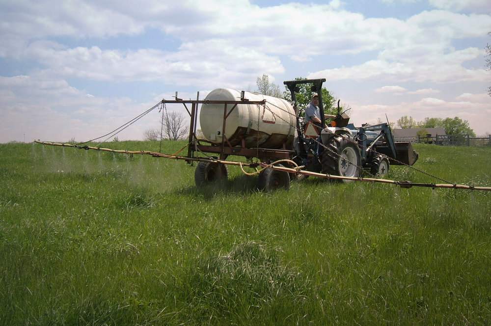Spraying organic liquid fertilizers on pastures