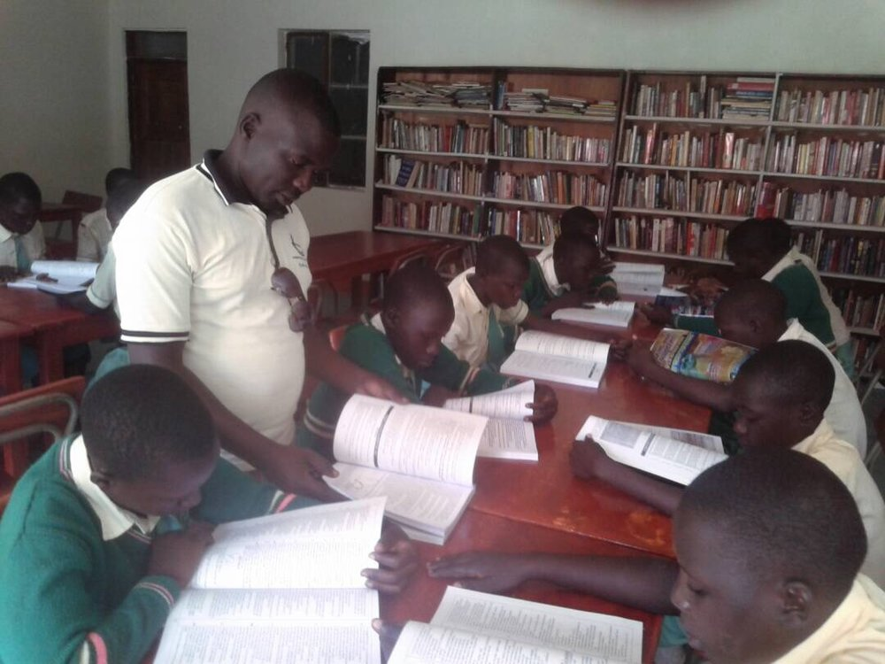 Students utilizing recently acquired study guides for the Primary School National Examinations.