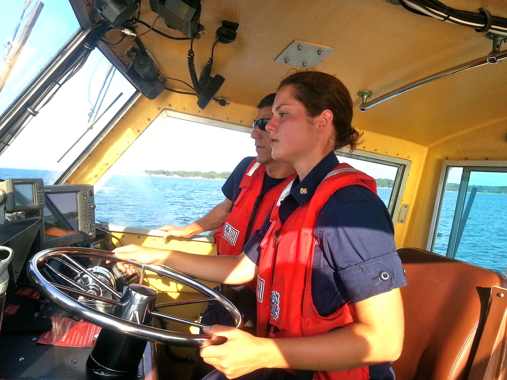 Wingler drives the 41-foot Utility Boat at Coast Guard Station Milford Haven, Va. under the supervision of Chief Petty Officer Dickinson. U.S. Coast Guard photo by auxiliarist Stephanie Hutton.