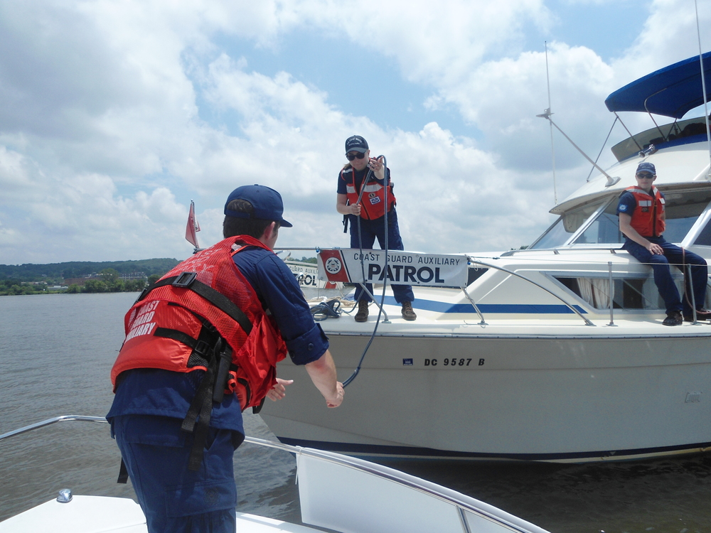 AUP students and staff work together during two boat operations on the Potomac River in Washington, D.C., June 20, 2013. U.S. Coast Guard photo.