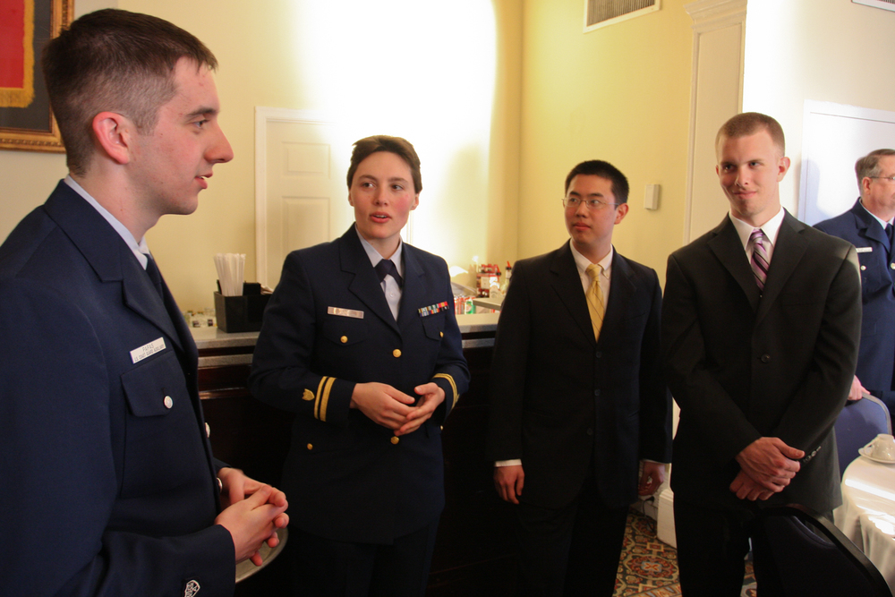 Students from Unit William & Mary converse with Lieutenant Geyer at AUP Dining Out, March 23, 2013. Lt. j.g. Geyer has served aboard Coast Guard Cutter Sycamore, home ported in Cordova, Alaska. U.S. Coast Guard photo by Auxiliarist Jonathan Roth.